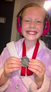 Esti showing off her medal after the Swimming Gala