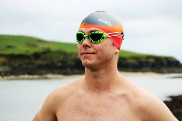 Michael Ventre preparing to swim in Open Water in his Predator Goggles and Zoggs Swim Cap