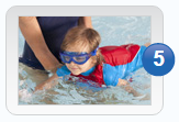 Boy learning how to swim