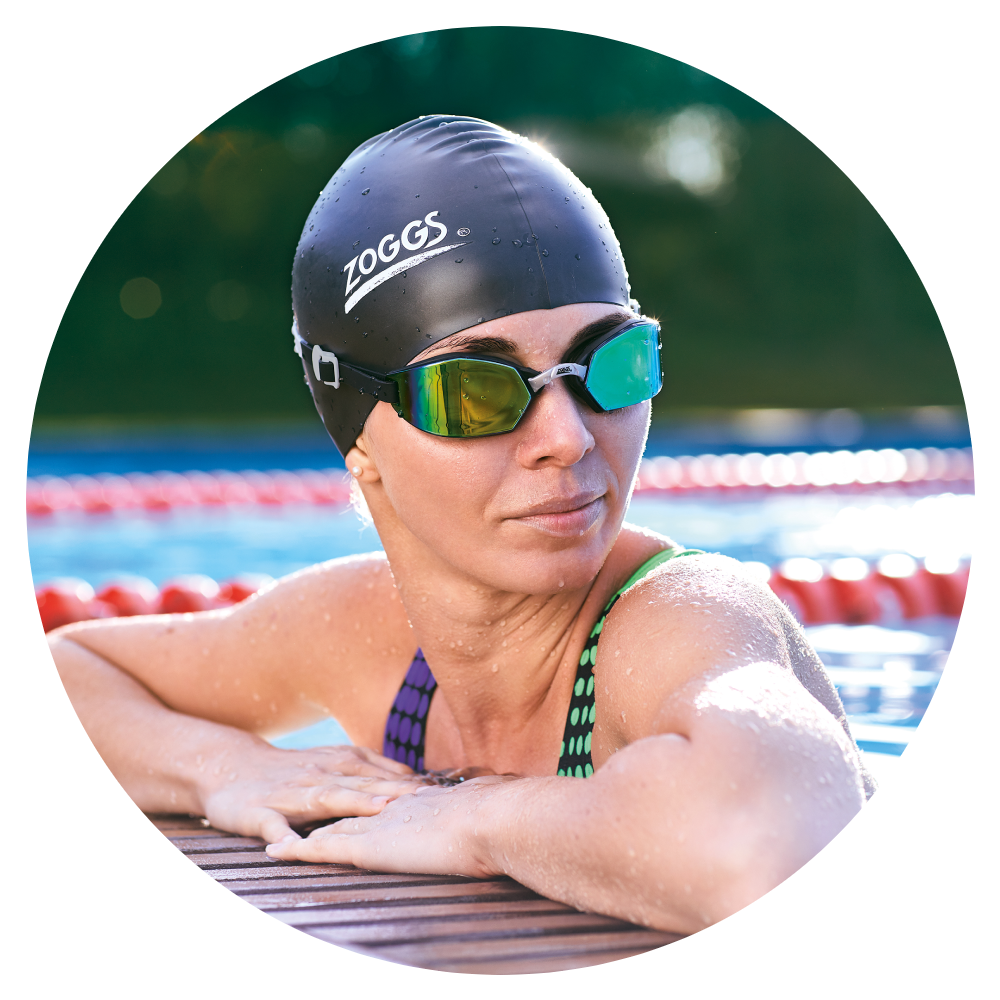Women wearing a swimming cap and goggle