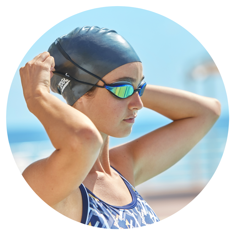Woman putting on a swimming cap and goggle