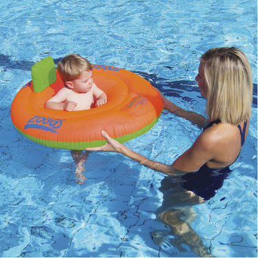 Blonde woman and baby with a swimring in the pool