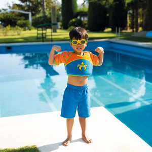 Boy who is standing near to the pool and wearing blue/orange Water Wings Vest